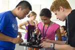 High-school students examining a quantum cryptography experiment